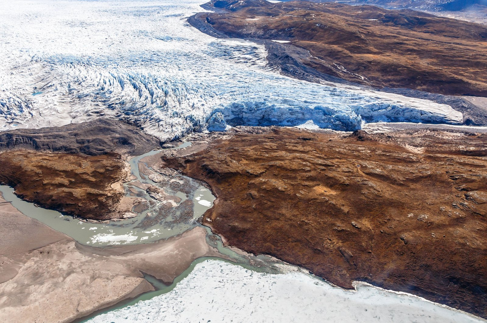 An aerial view shows theGreenlandic ice sheet, nearKangerlussuaq, Greenland. (Shutterstock Photo)