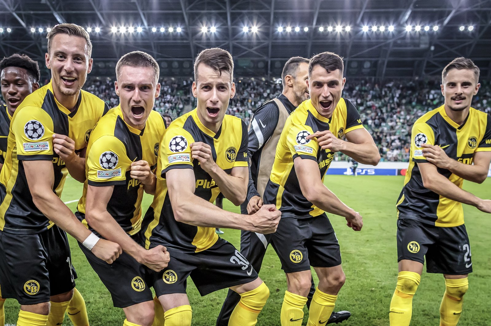 Young Boys' players celebrate their victory in the UEFA Champions League Playoff against Switzerland's Ferencvaros at the Groupama Arena stadium in Budapest, Hungary, Aug. 24, 2021. (EPA Photo)