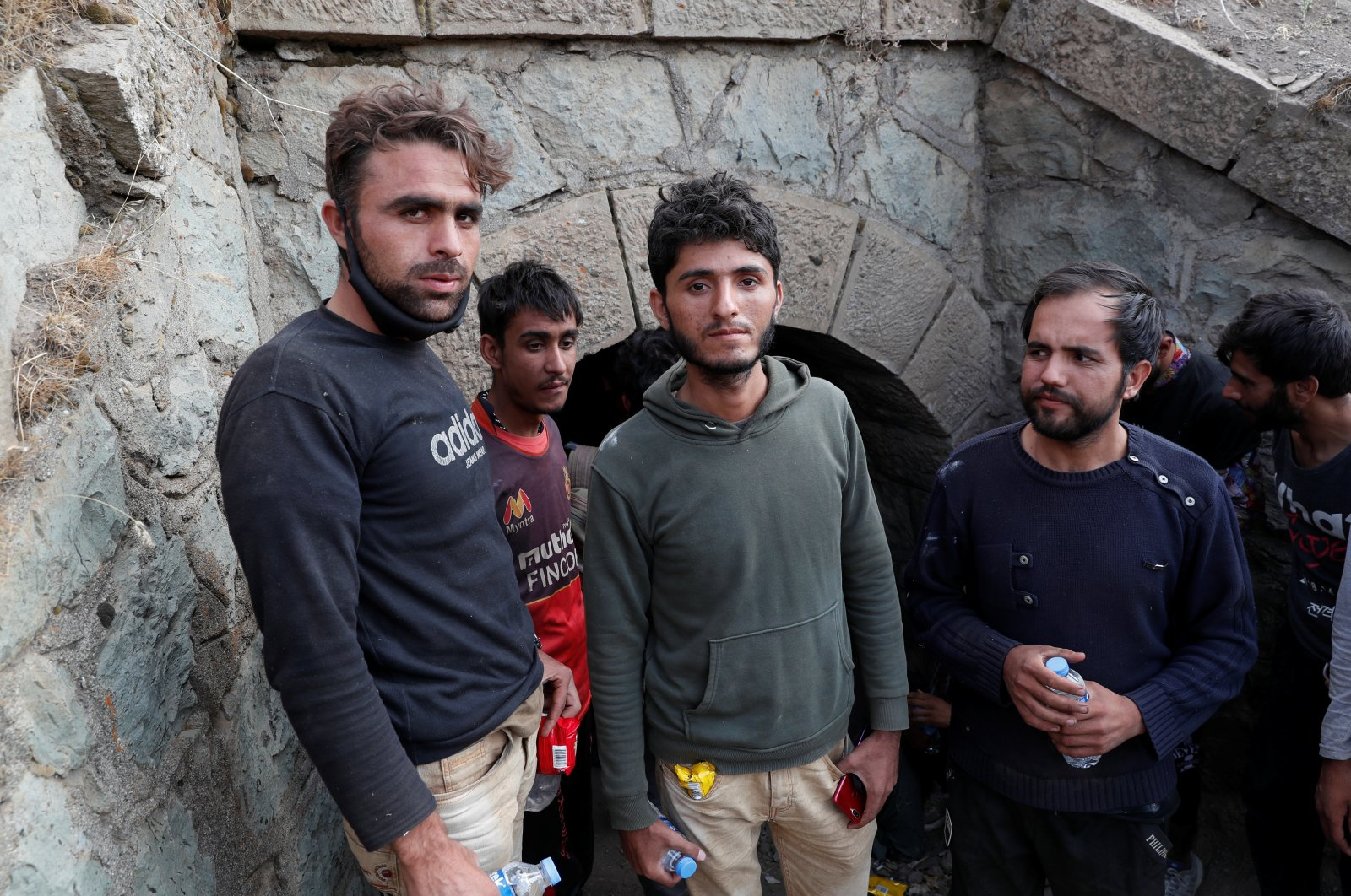 Muhammad Ali (C), an Afghan migrant from Khost who planned to found his own cryptocurrency mining business, and the other migrants hide from security forces after crossing illegally into Turkey from Iran, near Tatvan in Bitlis province, Turkey, Aug. 23, 2021. (Reuters Photo)