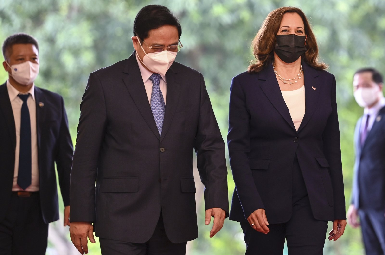 U.S. Vice President Kamala Harris, third from left, walks with Vietnamese Prime Minister Pham Minh Chinh at the government office in Hanoi, Vietnam, Aug. 25, 2021. (AP Photo)