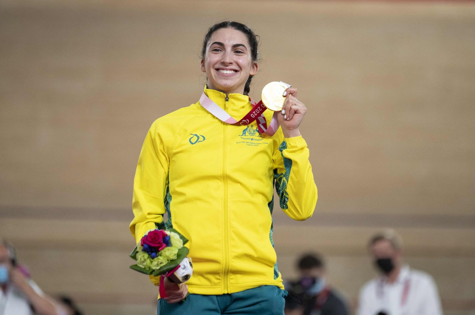 Gold medallist Australia's Paige Greco poses with her medal on the podium after the women's C1 3000m individual pursuit event during the Tokyo 2020 Paralympic Games at Izu Velodrome in Izu, Japan, Aug. 25, 2021. (AFP Photo)