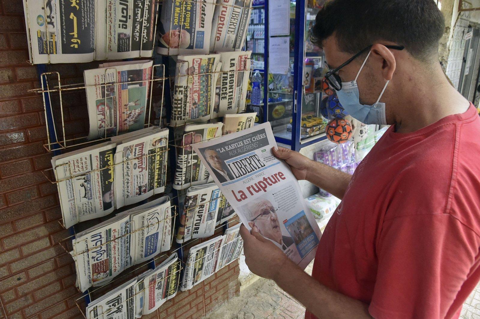 An Algerian man holds a newspaper in the capital Algiers, Algeria, Aug. 25, 2021. (AFP Photo)