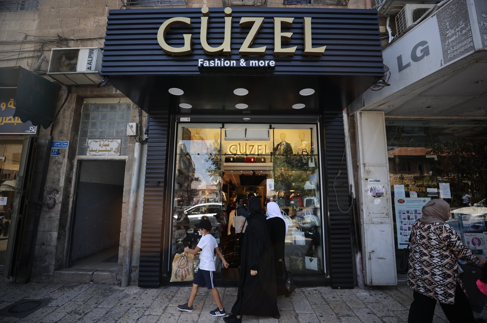 A clothing and accessories shop named Güzel (beautiful in Turkish) is seen along Salah al-Din Street in East Jerusalem, occupied Palestine, Aug. 19, 2021. (AA Photo)