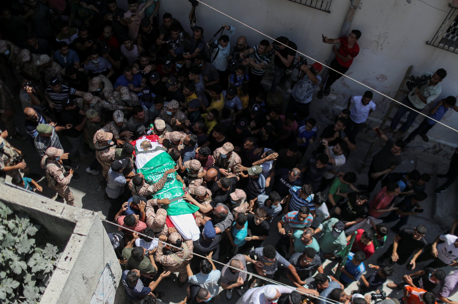 Mourners carry the body of Palestinian Osama Deeij, who died of a wound he sustained during an anti-Israel protest at the Israel-Gaza border fence on Saturday, Gaza Strip, Palestine, Aug. 25, 2021. (Reuters Photo)