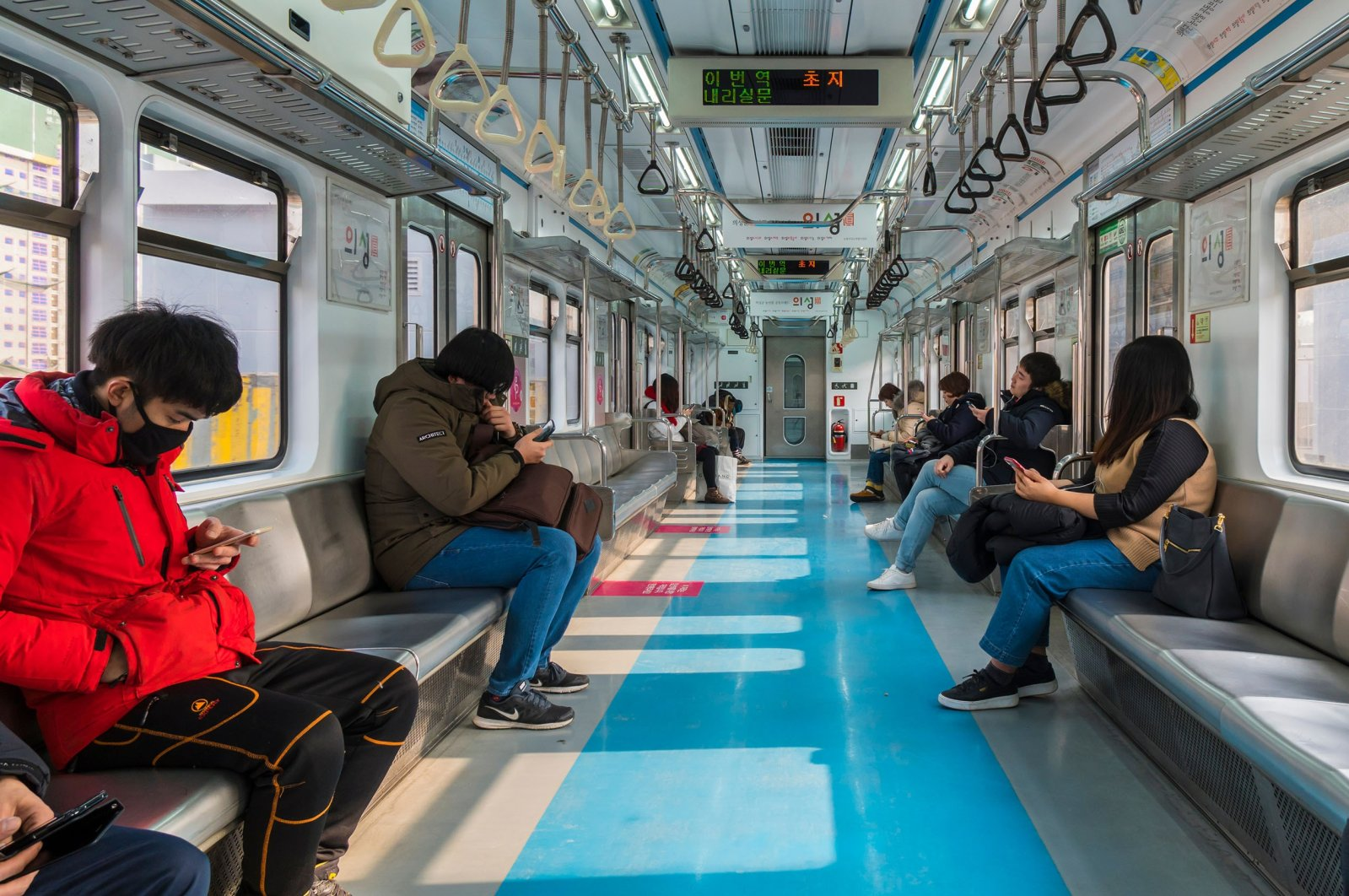 People check their smartphones in a subway, Seoul, South Korea, Jan. 28, 2018. (Shutterstock Photo)