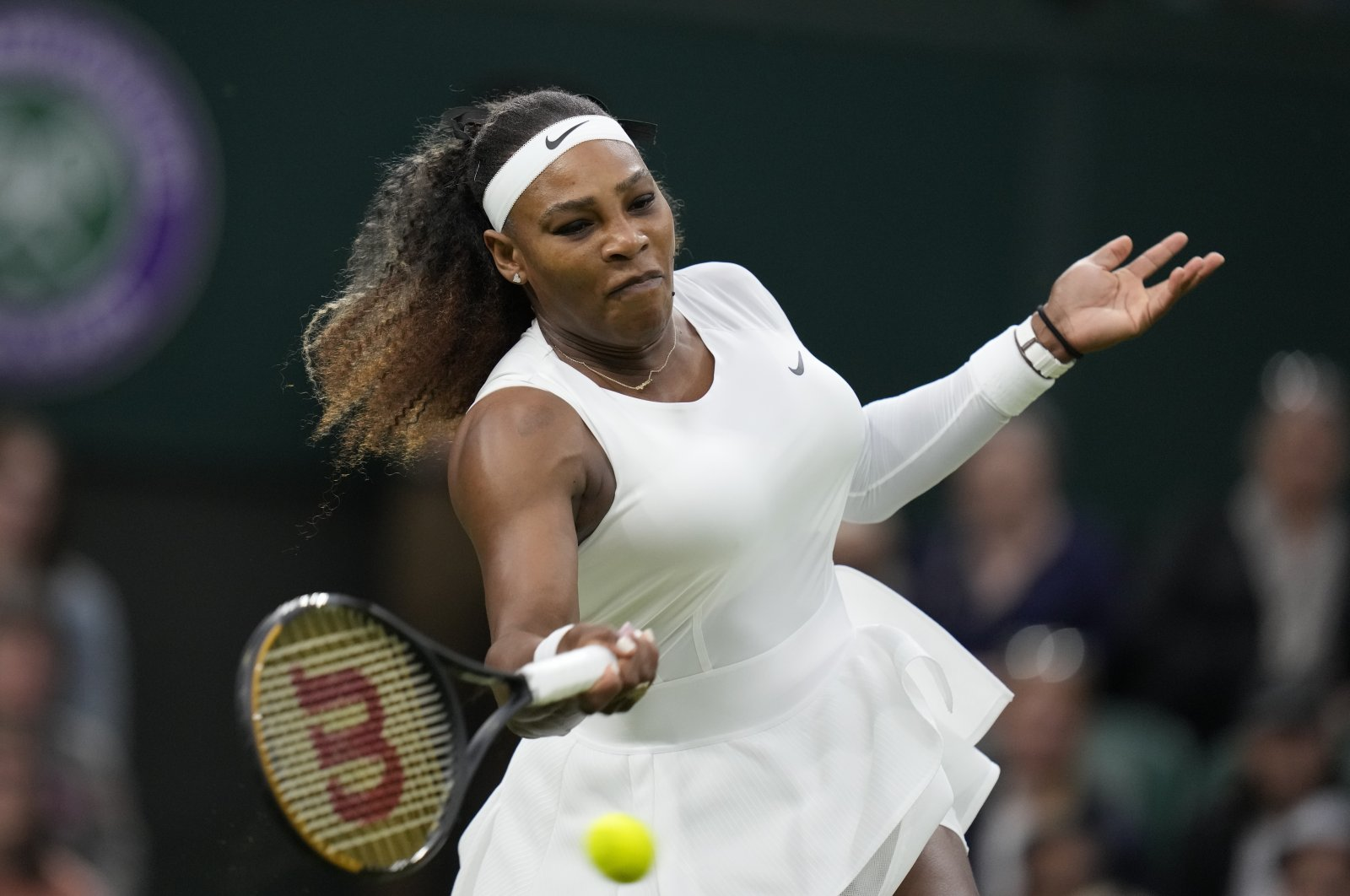 Serena Williams plays a return to Aliaksandra Sasnovich at a Wimbledon women's singles first-round match in London, England, June 29, 2021. (AP Photo)