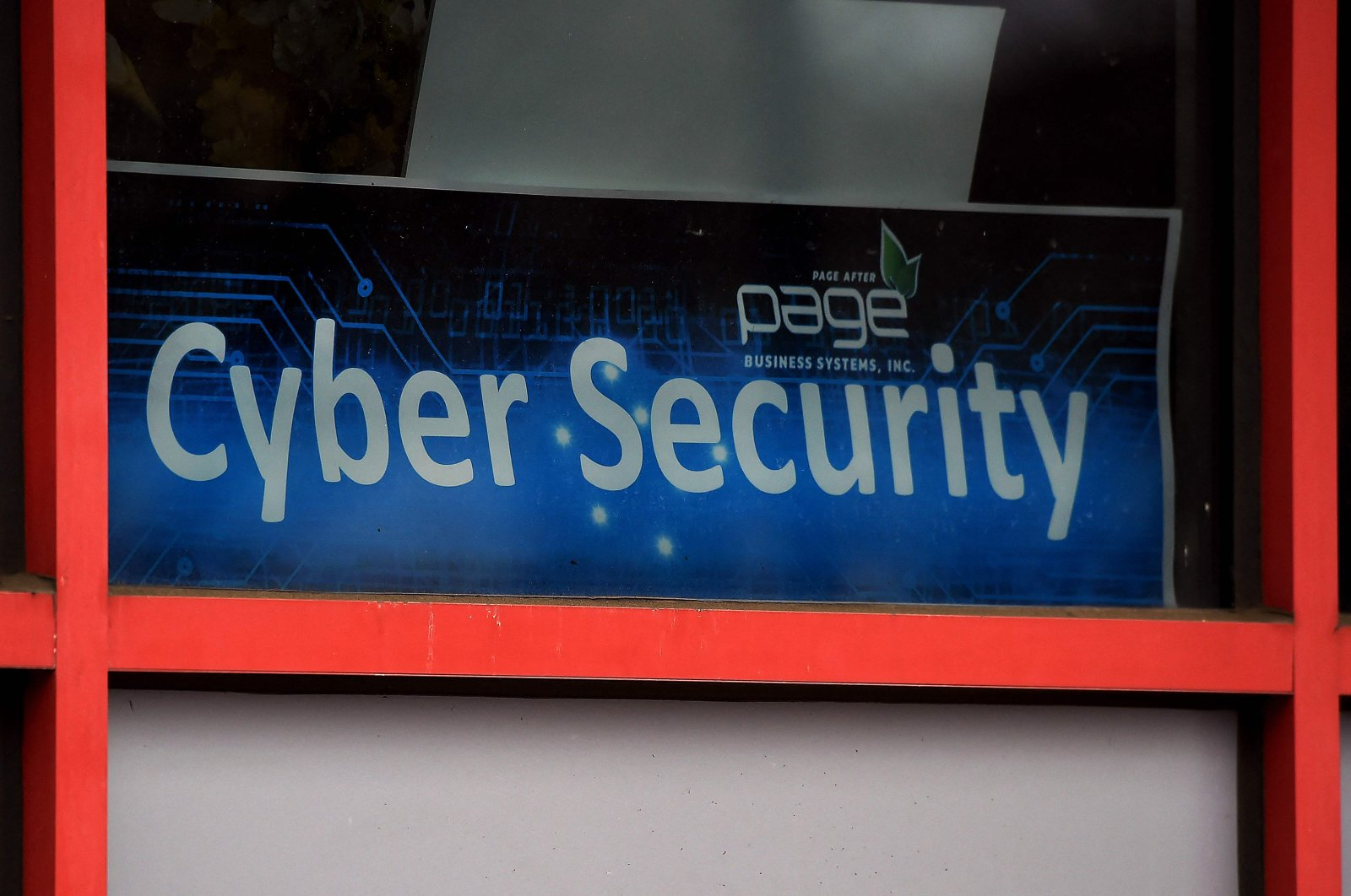 """A """"Cyber Security"""" sign is displayed in the window of a computer store in Arlington, Virginia, U.S., Dec. 18, 2020. (AFP Photo)"""