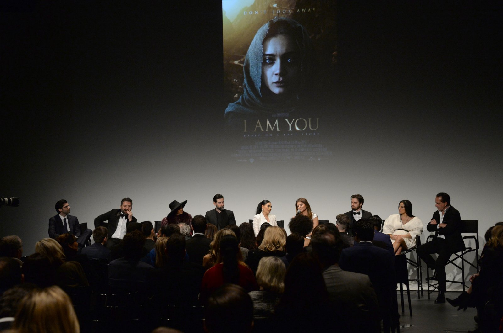 """From left,Chris Cole, Hakan Aydın, Halima Aden, Ali Pınar, Aryana Sayeed, Sonia Nassery Cole, Emre Çetinkaya, Cansu Tosun and Federico Pignatelli onstage at the New York premiere of """"I Am You,"""" at Pier 59 Studios, New York City, U.S.,Feb. 6, 2020. (Getty Images)"""
