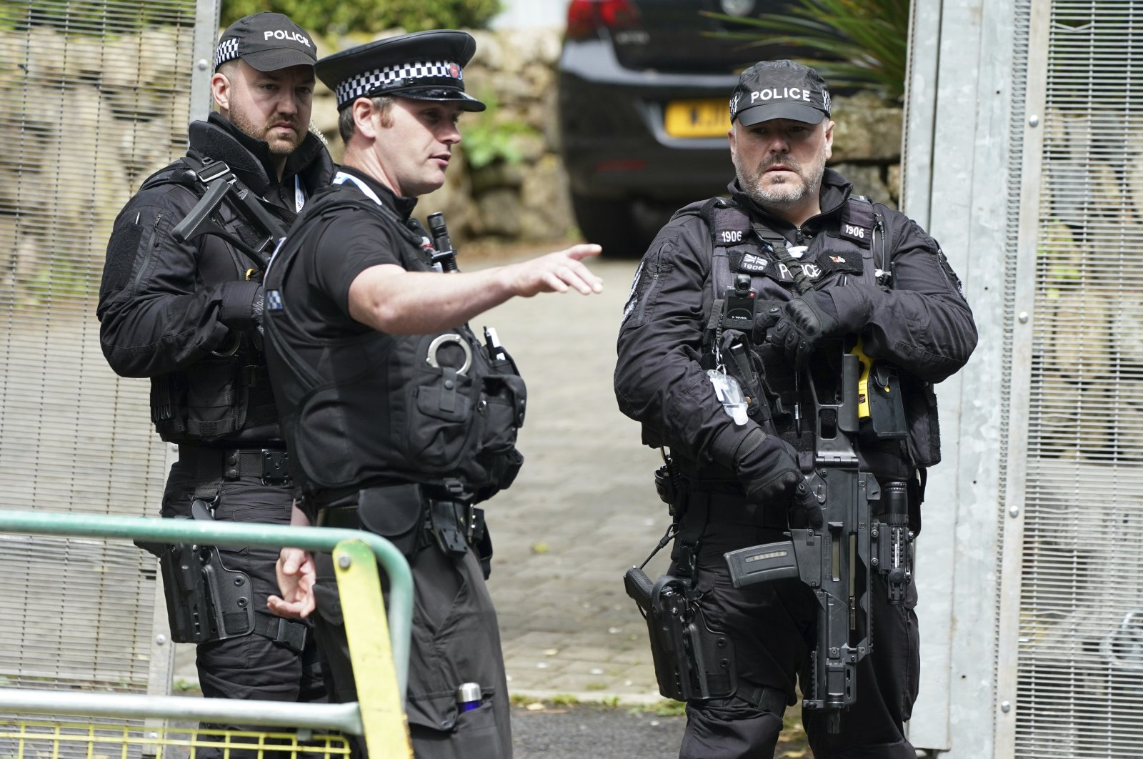 Police speak as they patrol a checkpoint in St. Ives, Cornwall, England, June 10, 2021. (AP Photo)