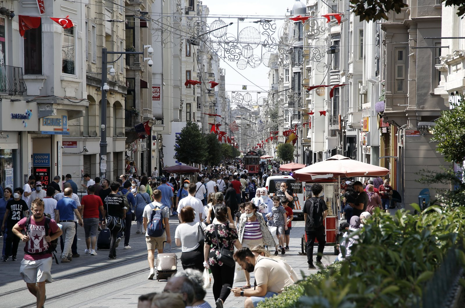 People walk in Istiklal Avenue, the main shopping street of Istanbul, Turkey, Aug. 25, 2021. (DHA Photo)