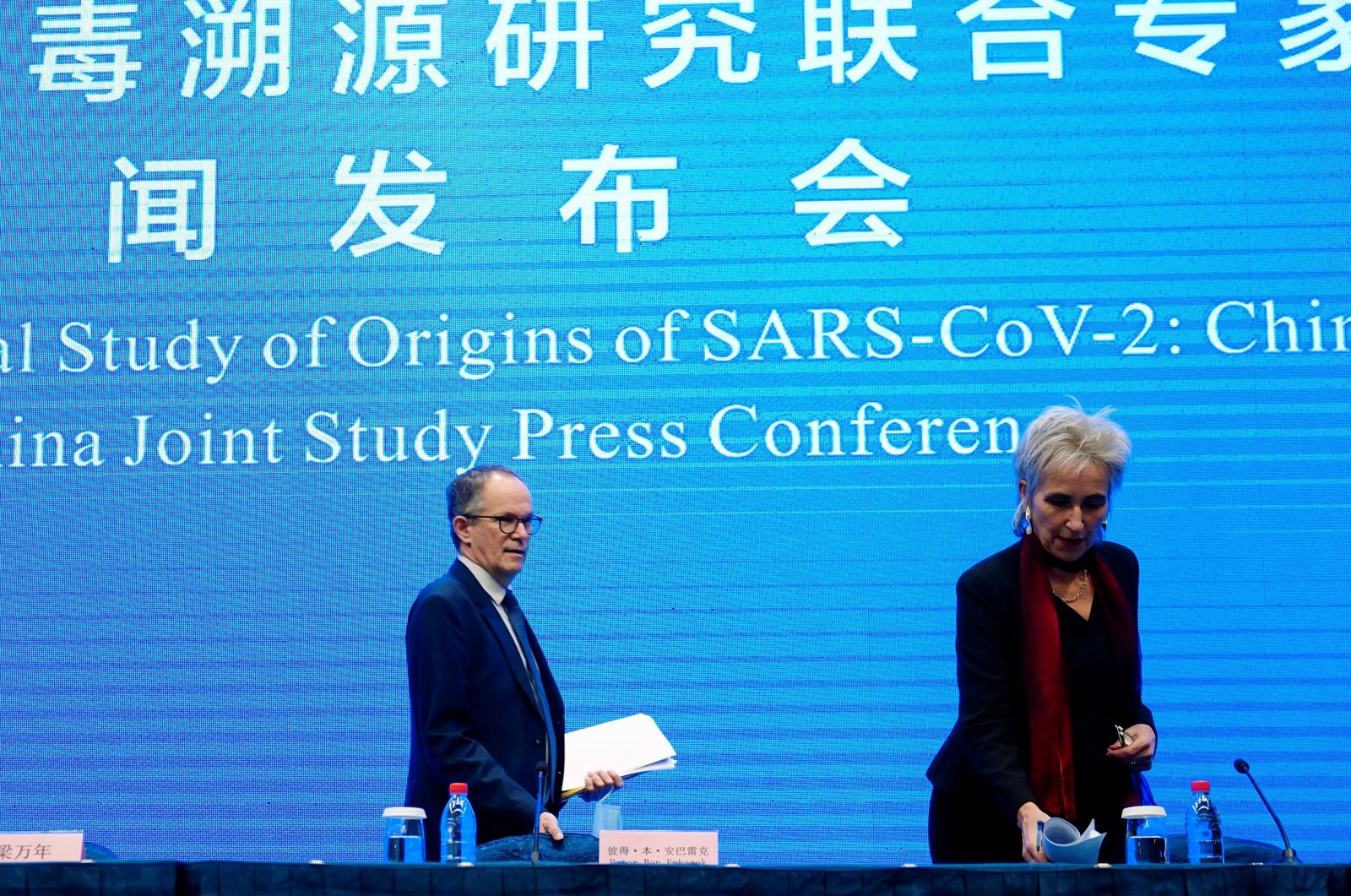 Peter Ben Embarek and Marion Koopmans, members of the World Health Organization (WHO) team tasked with investigating the origins of the coronavirus disease, arrive for the WHO-China joint study news conference at a hotel in Wuhan, Hubei province, China, Feb. 9, 2021. (REUTERS Photo)