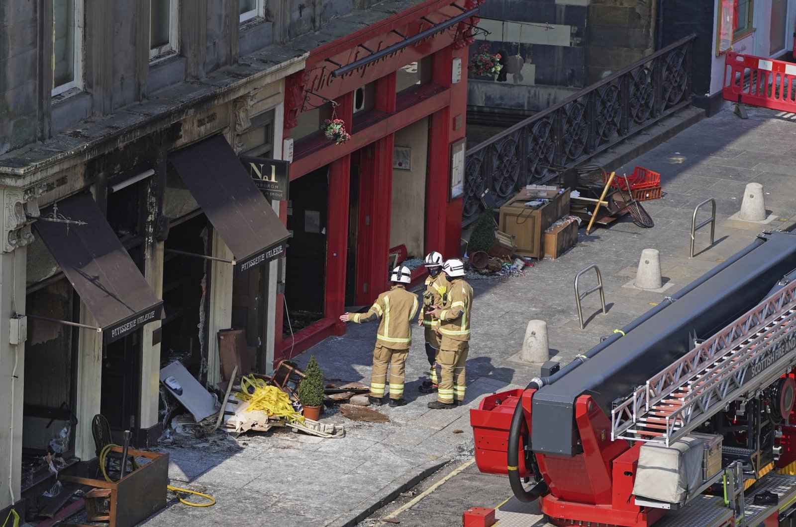 Firefighters at the scene after a fire at the Elephant House Cafe in Edinburgh, U.K., Aug. 25, 2021. (Andrew Milligan / PA via AP)