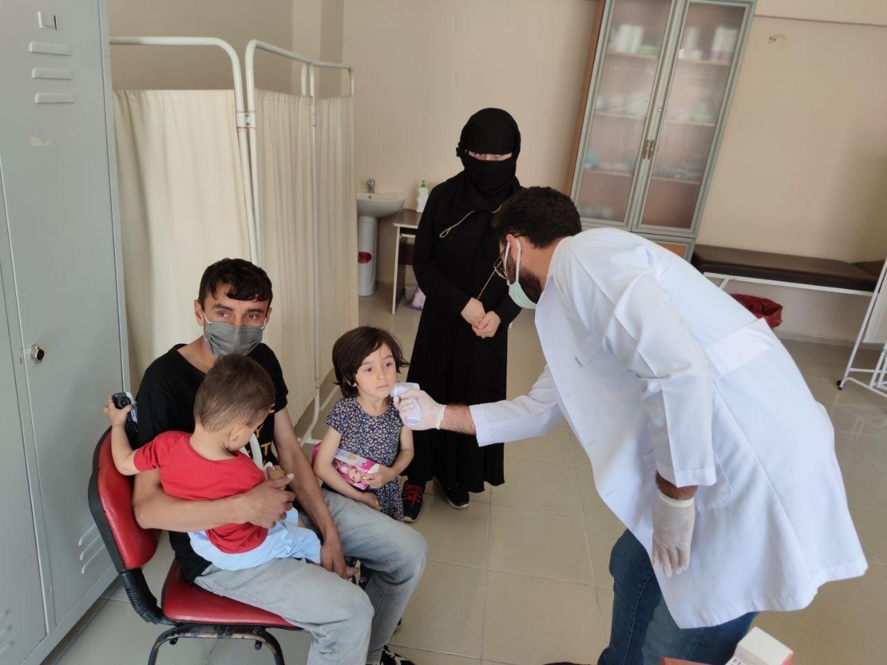 Irregular migrants attend health checks in Van province, Turkey, Aug. 22, 2021 (IHA Photo)