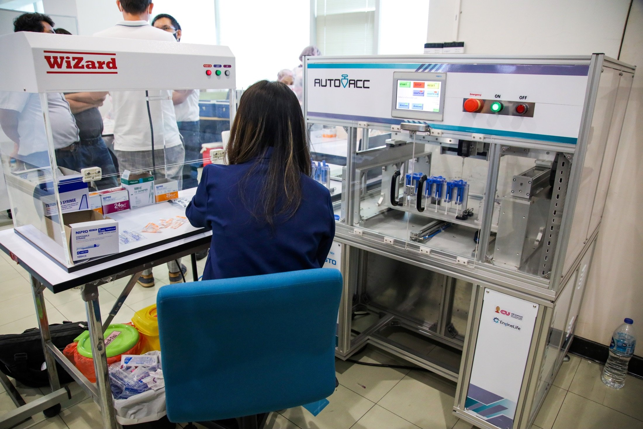 A technician works at AutoVacc vaccine extraction machine designed by the Chulalongkorn University's Biomedical Engineering Research Center, in Bangkok, Thailand, Aug. 23, 2021. (Reuters Photo)