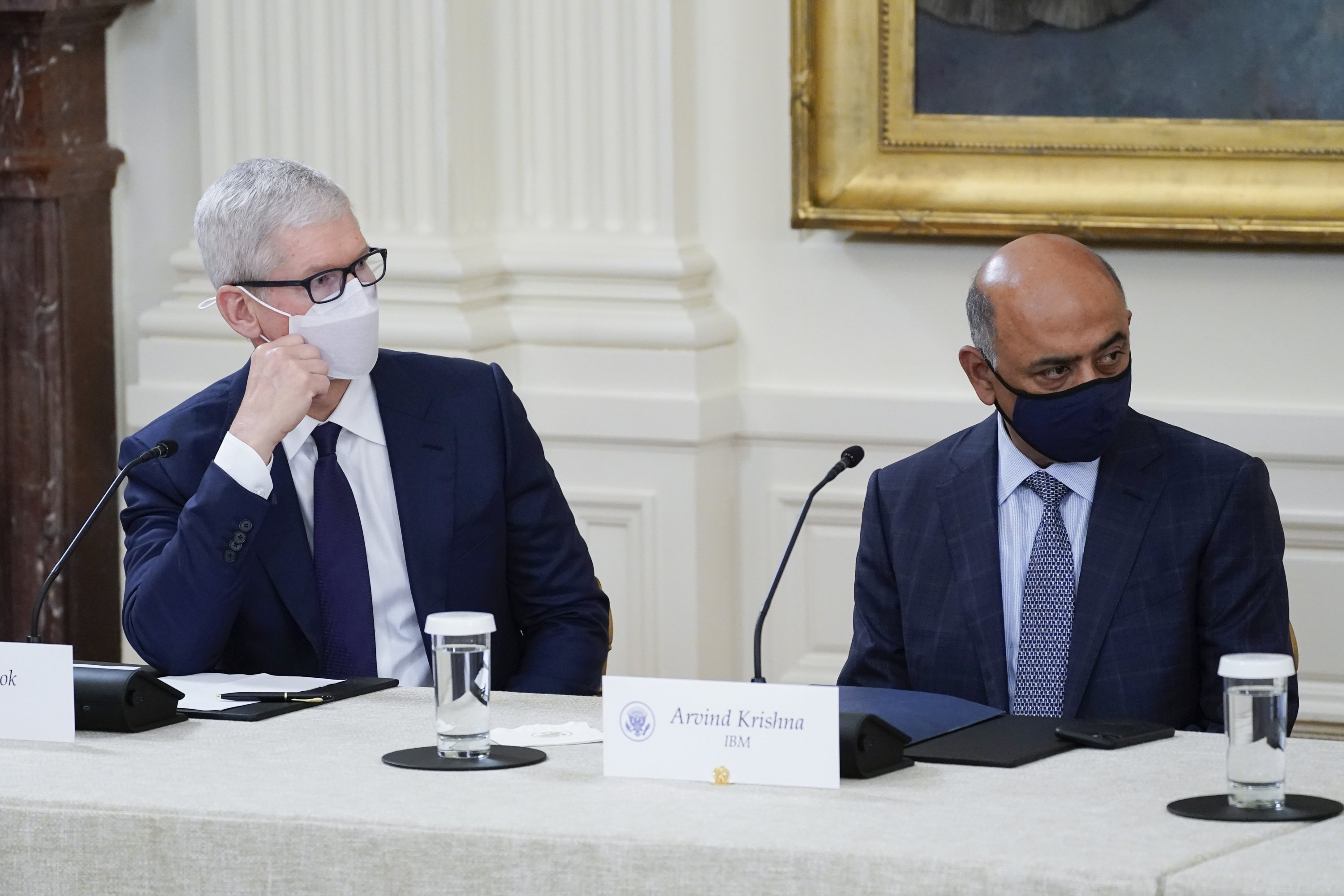 Apple CEO Tim Cook (L) and IBM CEO Arvind Krishna listen as U.S. President Joe Biden speaks during a meeting about cybersecurity in the East Room of the White House, in Washington, U.S., Aug. 25, 2021. (AP Photo)