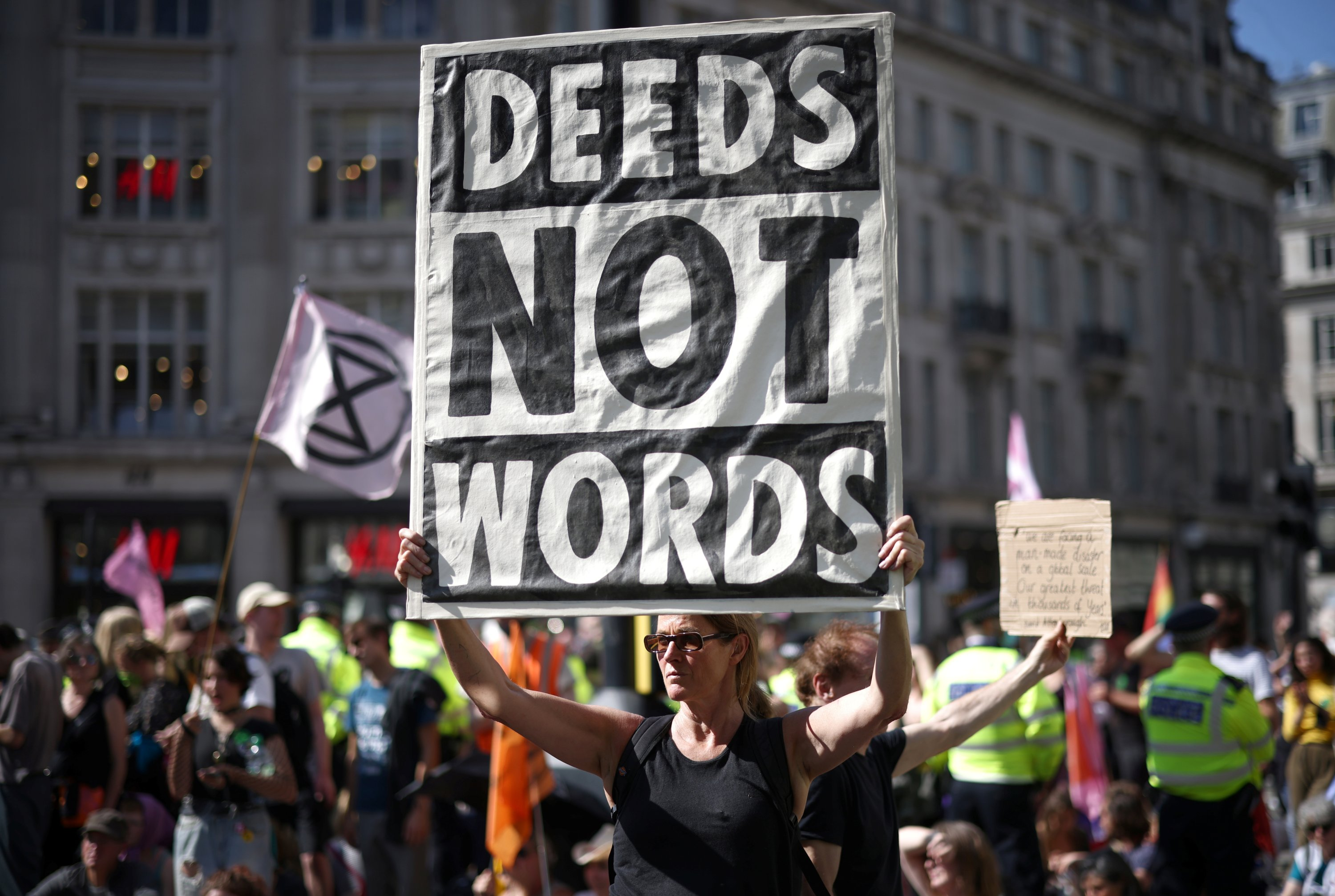 Demonstrators hold placards during an Extinction Rebellion climate activists' protest, at Oxford Circus, in London, Britain, Aug. 25, 2021. (Reuters Photo)