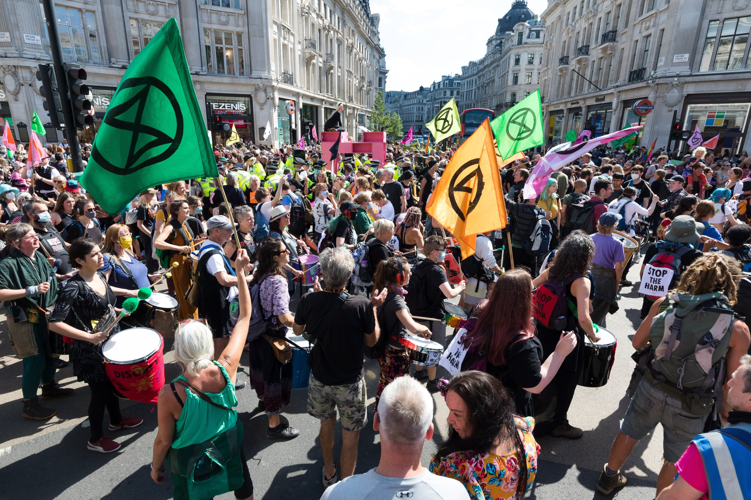 Extinction Rebellion demonstrators protest in the road in Oxford Circus during an Extinction Rebellion climate activists' protest in London, Britain, Aug. 25, 2021. (EPA Photo)