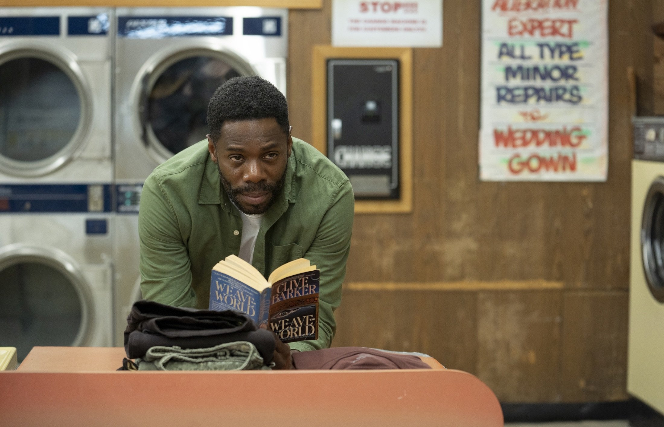 """Colman Domingo asWilliam Burke looks up from a book, in a scene from the film """"Candyman,""""directed by Nia DaCosta. (AP Photo)"""