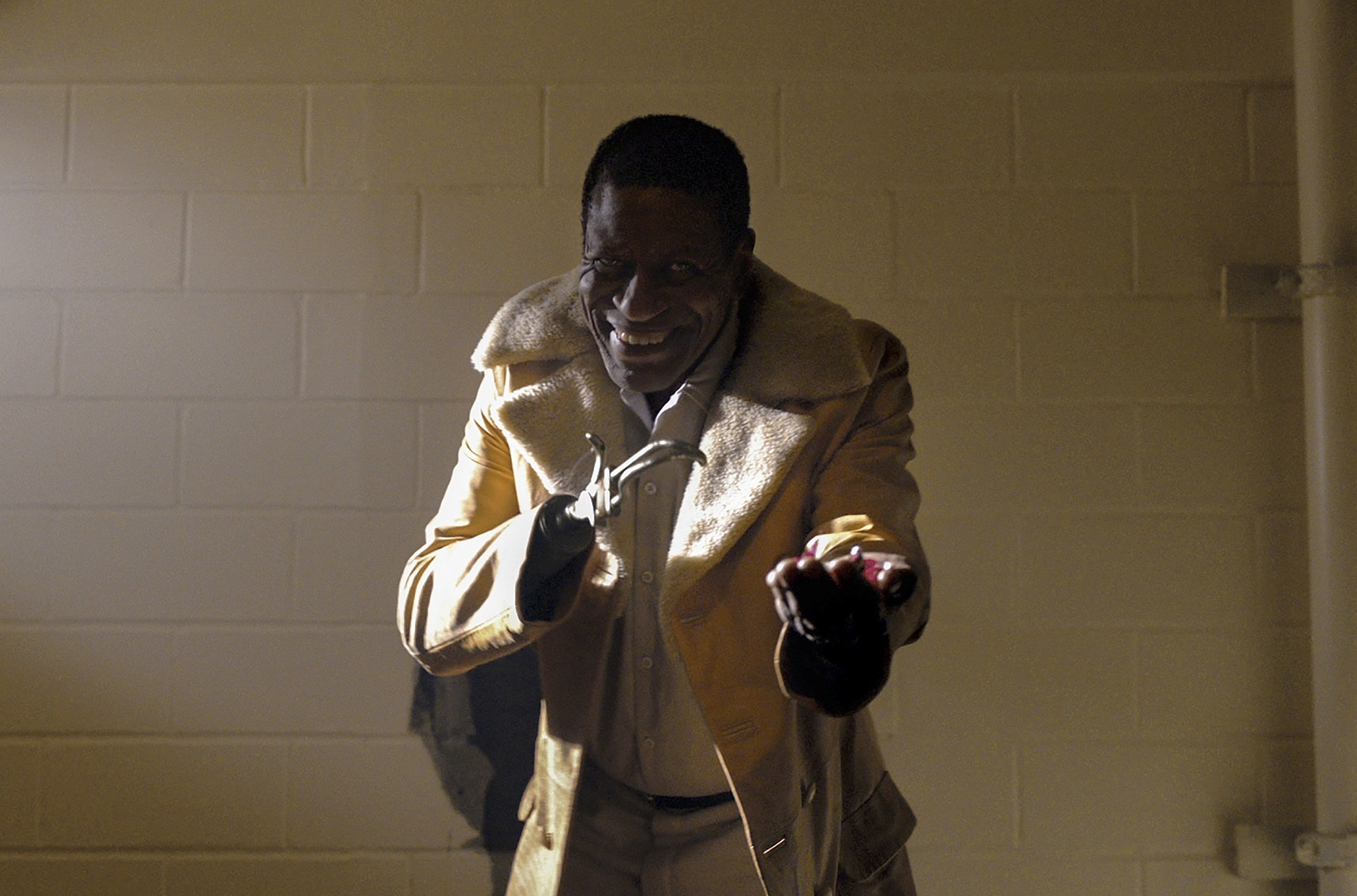 """Michael Hargrove as Sherman Fields smiles and gestures, in a scene from the film """"Candyman,"""" directed by Nia DaCosta. (AP Photo)"""
