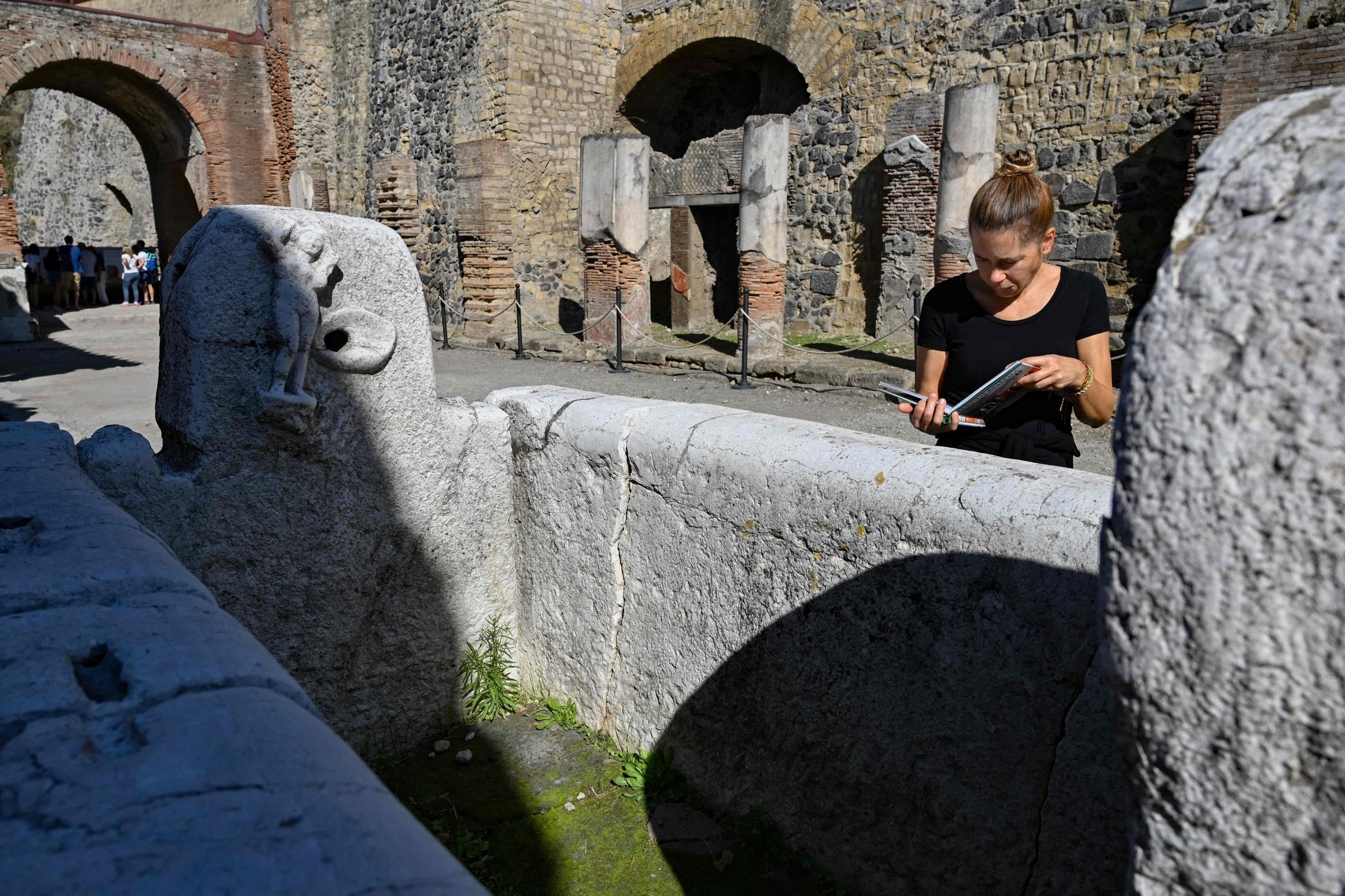 A visitor walks through the archaeological site of Herculaneum in Ercolano, near Naples, Italy, Oct. 23, 2019. (AFP Photo)