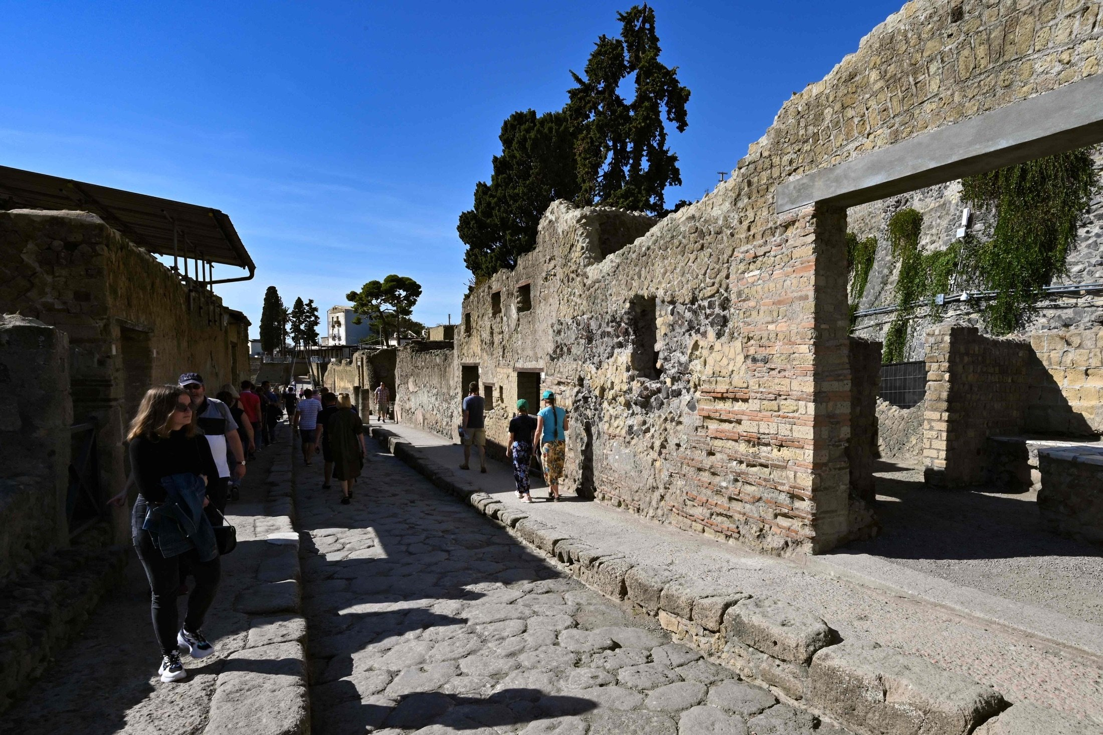 Visitors walk through the archaeological site of Herculaneum in Ercolano, near Naples, Italy, Oct. 23, 2019. (AFP Photo)