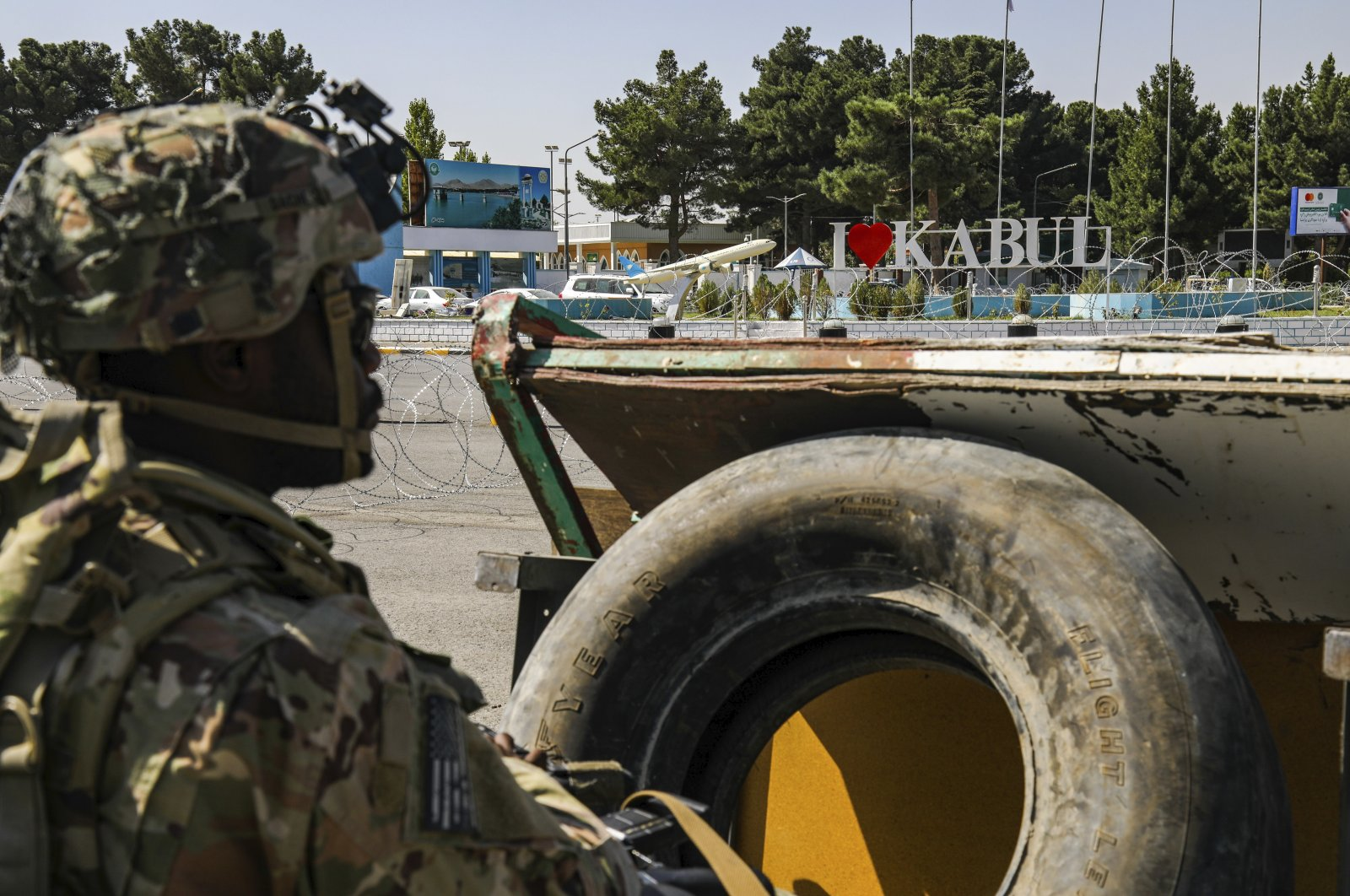 In this image provided by the U.S. Army, a paratrooper assigned to the 1st Brigade Combat Team, 82nd Airborne Division monitors security during evacuations at Kabul Hamid Karzai International Airport, Afghanistan, Aug 25, 2021. (Sgt. Jillian G. Hix/U.S. Army via AP)