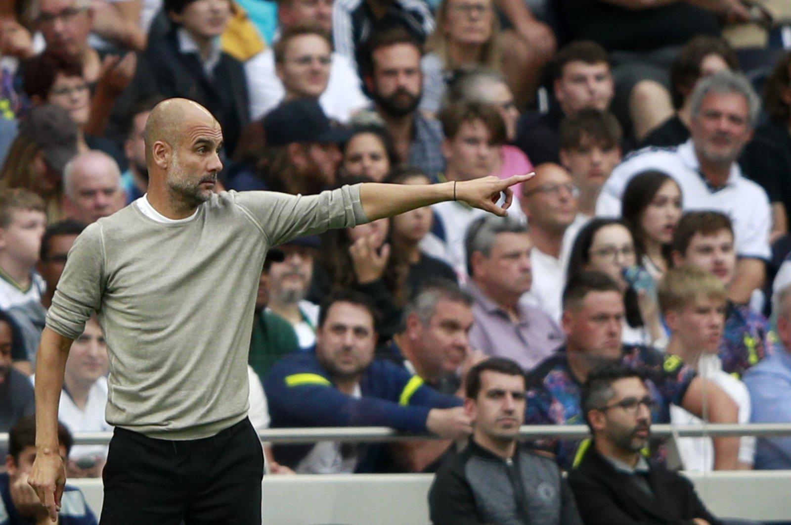 Manchester City's manager Pep Guardiola reacts during a Premier League match against Tottenham Hotspur in London, England, Aug. 15, 2021. (AP Photo)