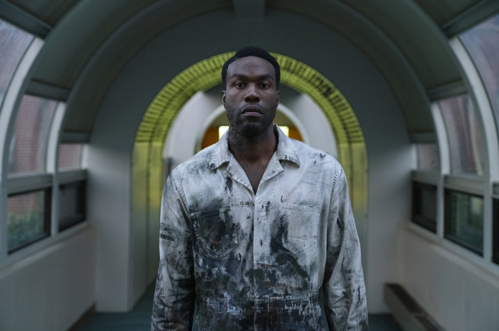 """Yahya Abdul-Mateen II as Anthony McCoy, in a scene from the film """"Candyman,""""directed by Nia DaCosta. (AP Photo)"""