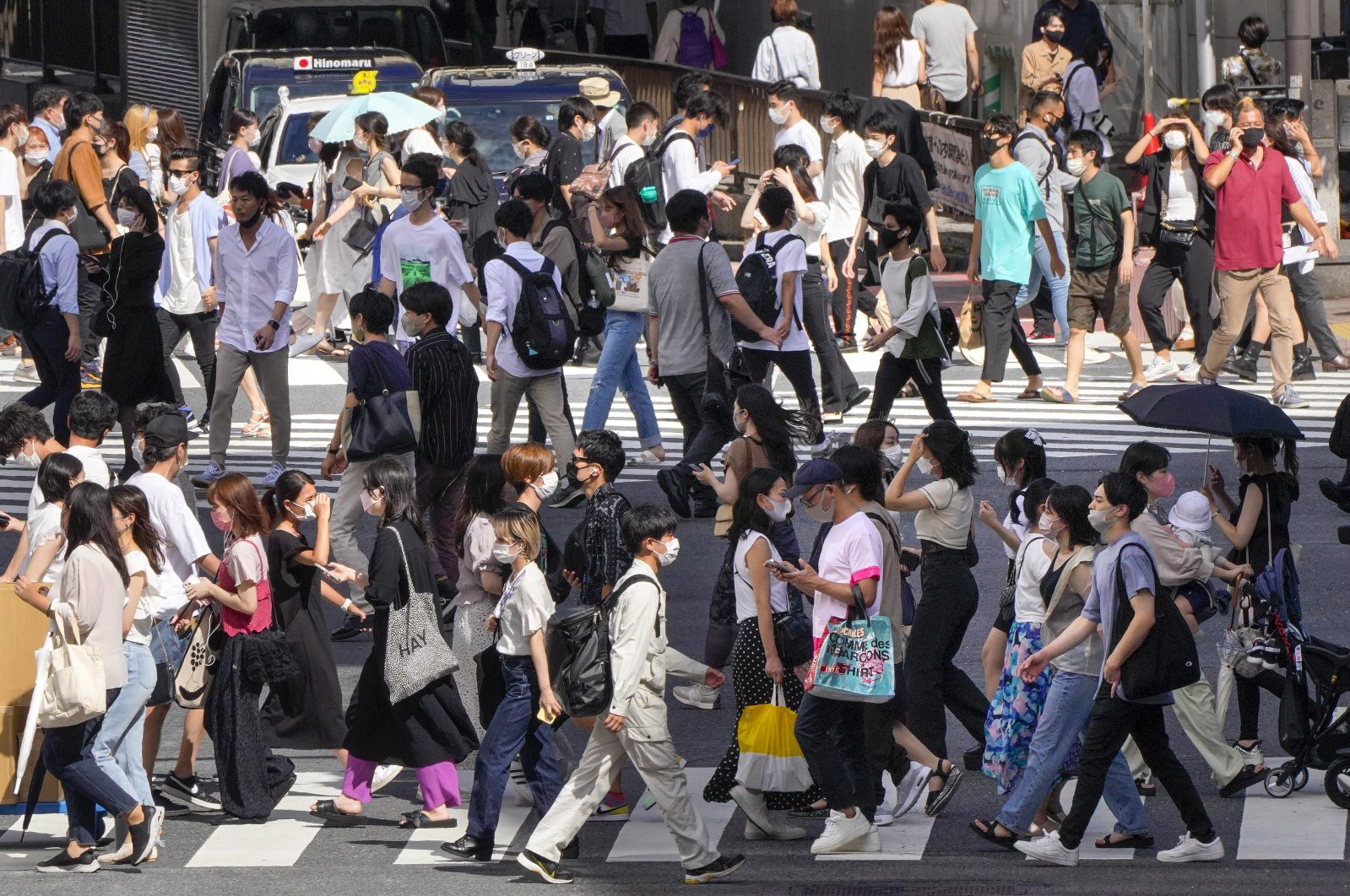 Pedestrians walk a crossway in Tokyo, Japan, Aug. 18, 2021. (EPA Photo)