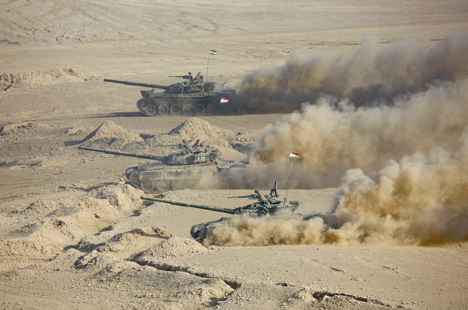 Tajikistan's tanks roll during joint military drills by Russia and Uzbekistan at Harb-Maidon firing range about 20 kilometers (about 12 miles) north of the Tajik border with Afghanistan, in Tajikistan, Aug. 10, 2021. (AP Photo)