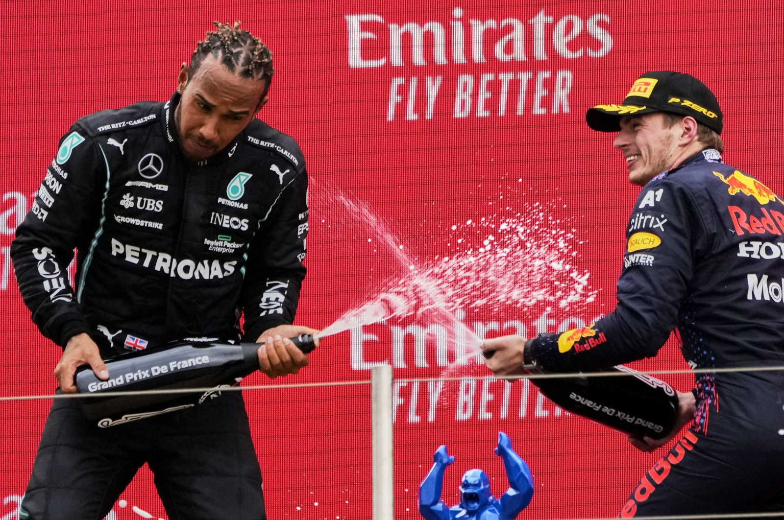 Red Bull driver Max Verstappen (R) celebrates winning the French Formula One Grand Prix with second-placed Lewis Hamilton at the Paul Ricard racetrack in Le Castellet, southern France, June 20, 2021. (AP Photo)