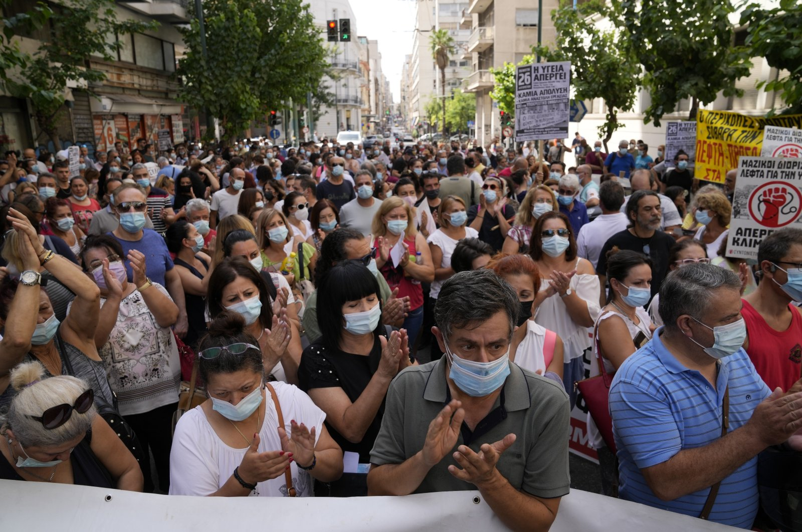 Health workers take part in a rally in Athens, Greece, Aug. 26, 2021. (AP Photo)