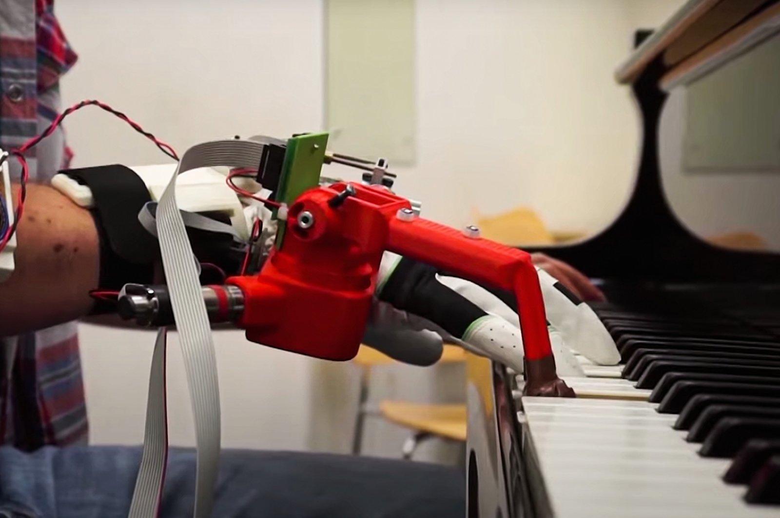 A still shot from a YouTube video showcasing Aldo Faisal's robotic third thumb experiment. (Faisal Lab via YouTube)