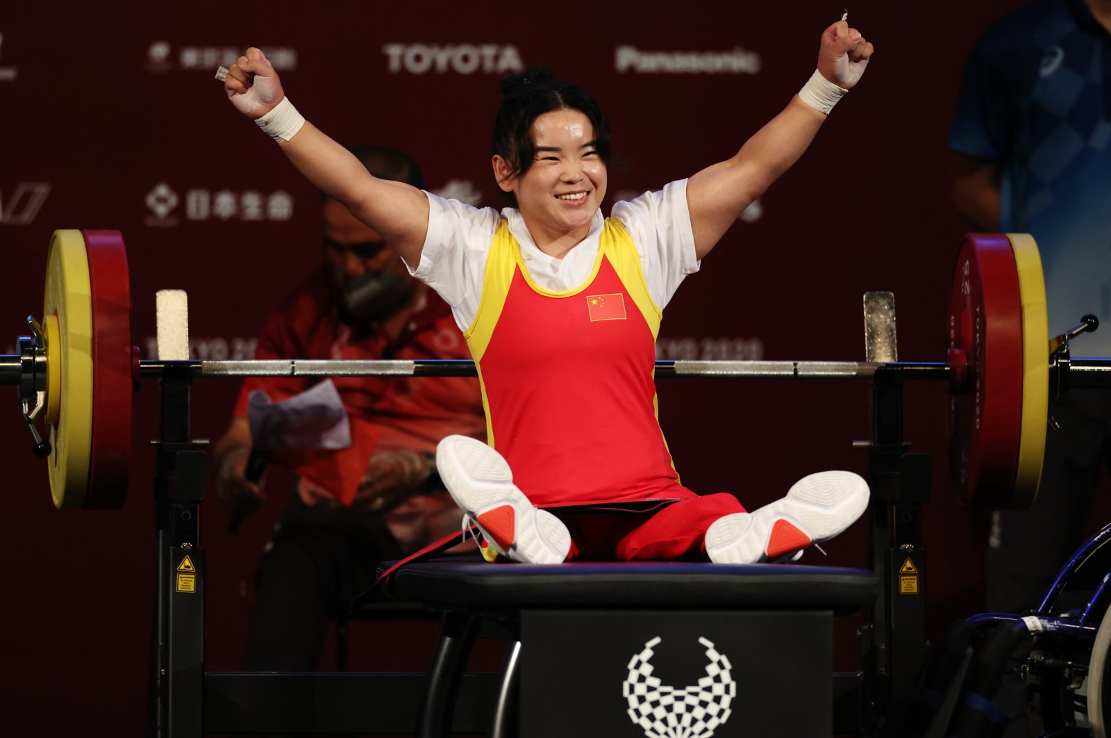 China's Guo Lingling celebrates winning women's 41-kilogram powerlifting gold at the Tokyo 2020 Paralympic Games, Tokyo, Japan, Aug. 26, 2021. (Reuters Photo)