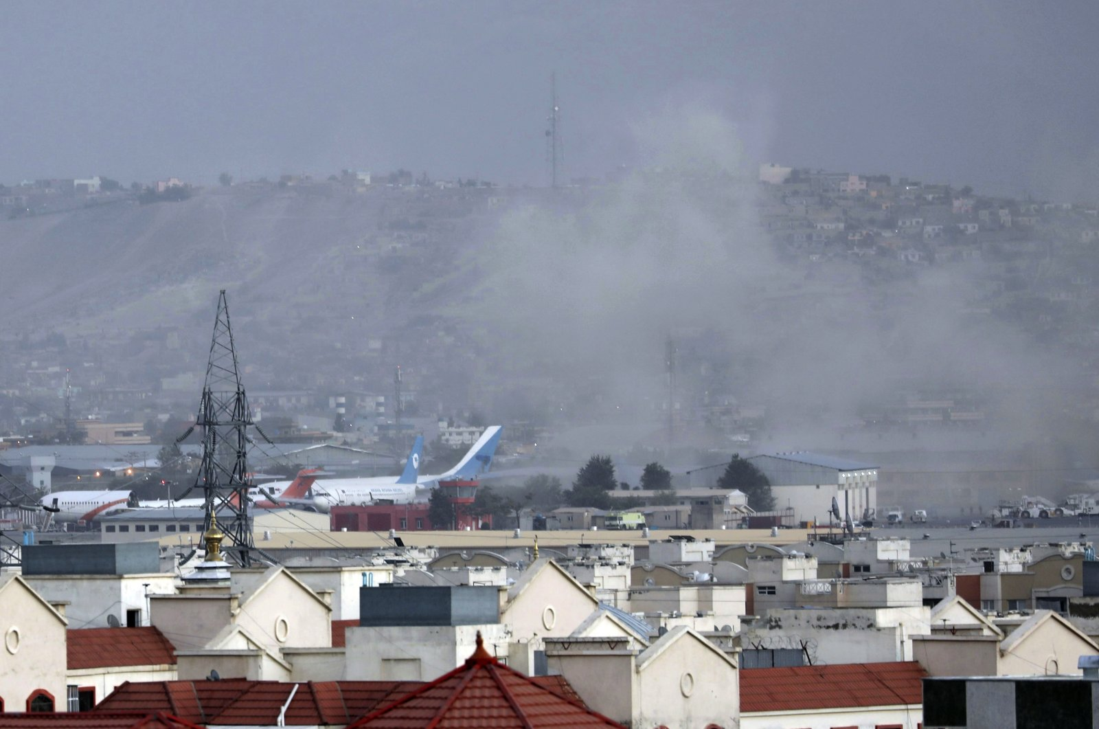 Smoke rises from a deadly explosion outside the airport in Kabul, Afghanistan, Aug. 26, 2021. (AP Photo)
