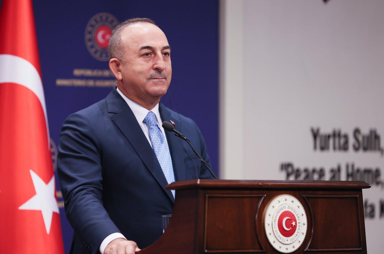 Foreign Minister Mevlüt Çavuşoğlu listens during a press conference in Ankara, Turkey, Aug. 24, 2021. (AA Photo)