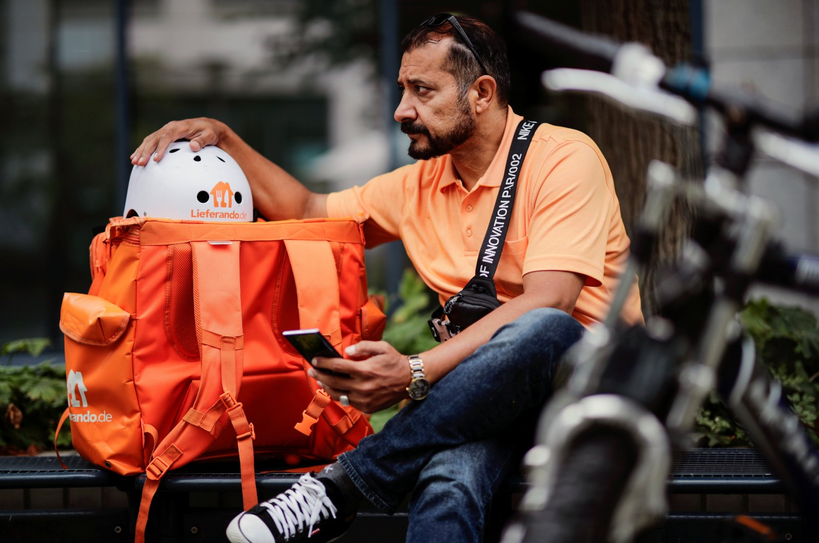 Former Afghan Communication Minister Sayed Sadaat sits with his gear as he works for the food delivery service Lieferando in Leipzig, Germany, Aug. 26, 2021. (REUTERS Photo)