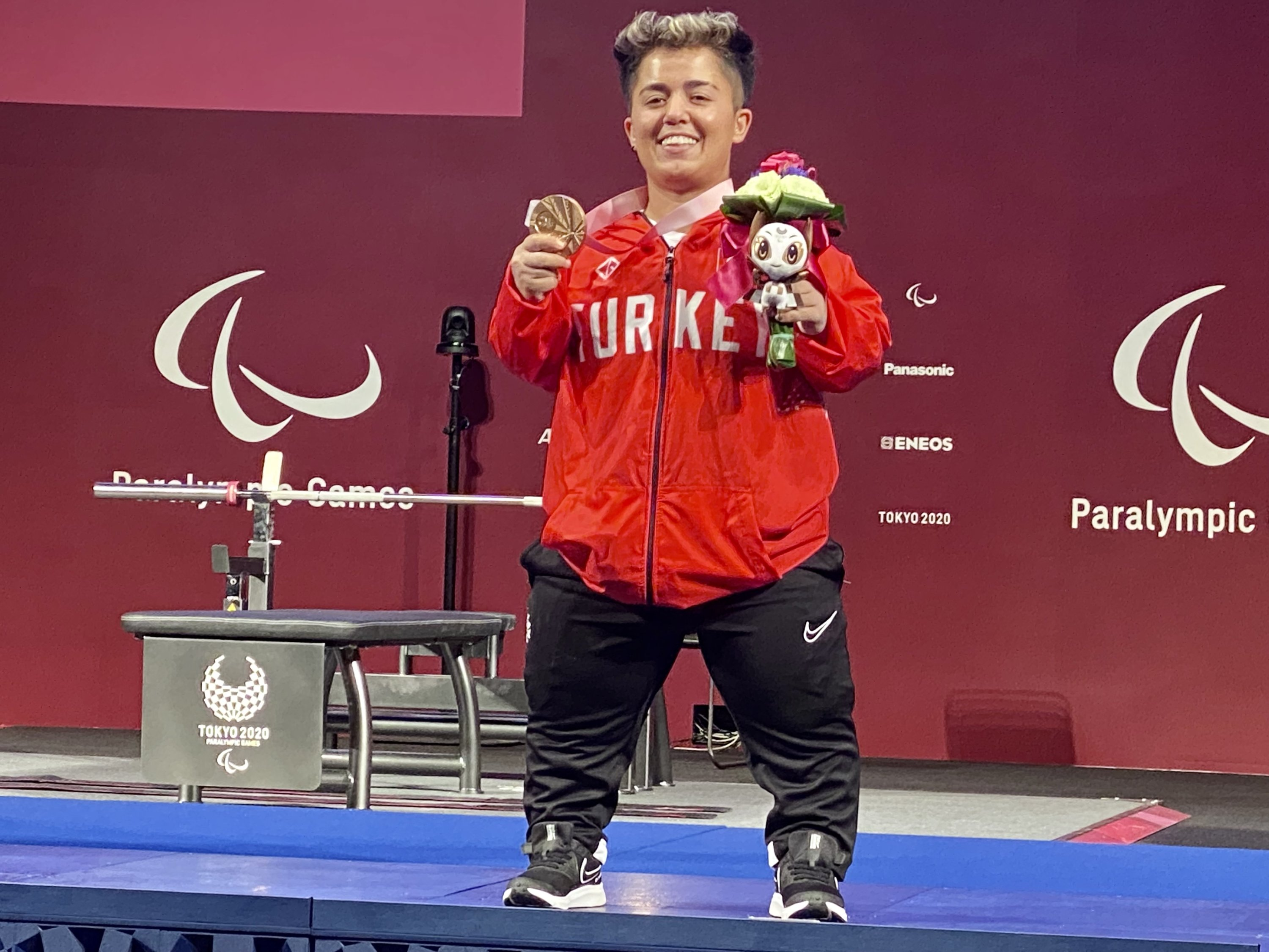 Turkish powerlifter Besra Duman poses for a photo with her bronze medal at the Tokyo 2020 Paralympics, in Tokyo, Japan, Aug. 27, 2021. (AA Photo)