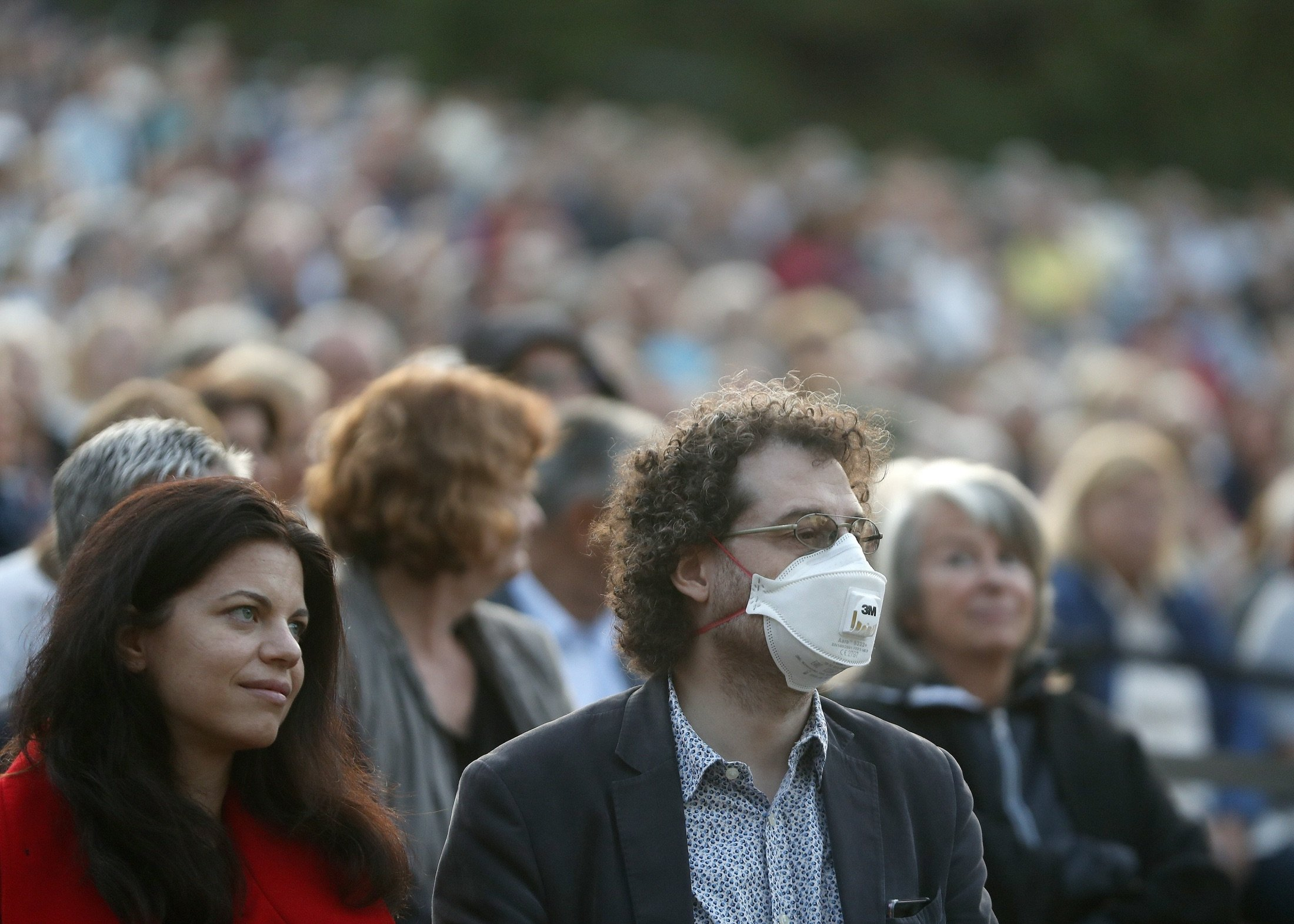 People attend a free concert of the Budapest Festival Orchestra in Budapest, Hungary, Aug. 25, 2021. (AP Photo)