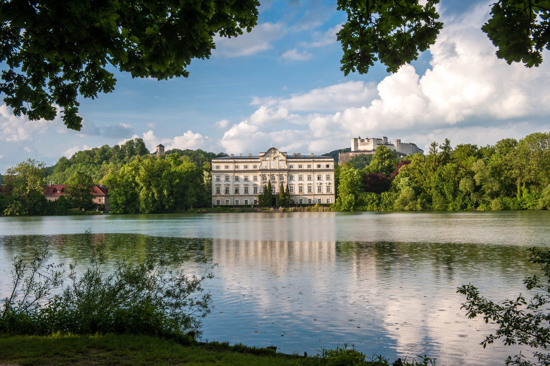 In the distance behind Leopoldskron Castle lies Hohensalzburg Fortress. (G.Breitegger/Tourismus Salzburg GmbH via dpa)