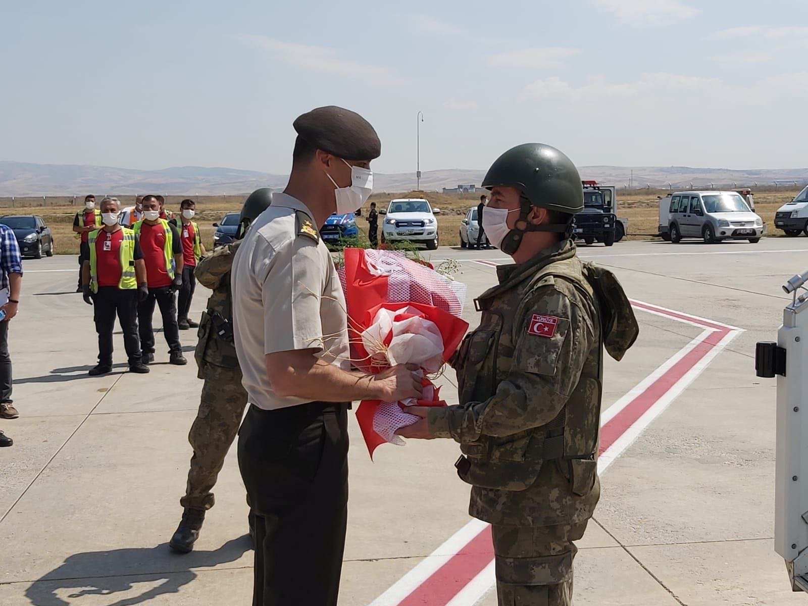 Turkish soldiers arriving from Afghanistan welcomed in Esenboga airport in Ankara in this photo released by the Defense Ministry. (Turkey's Defense Ministry via Twitter)