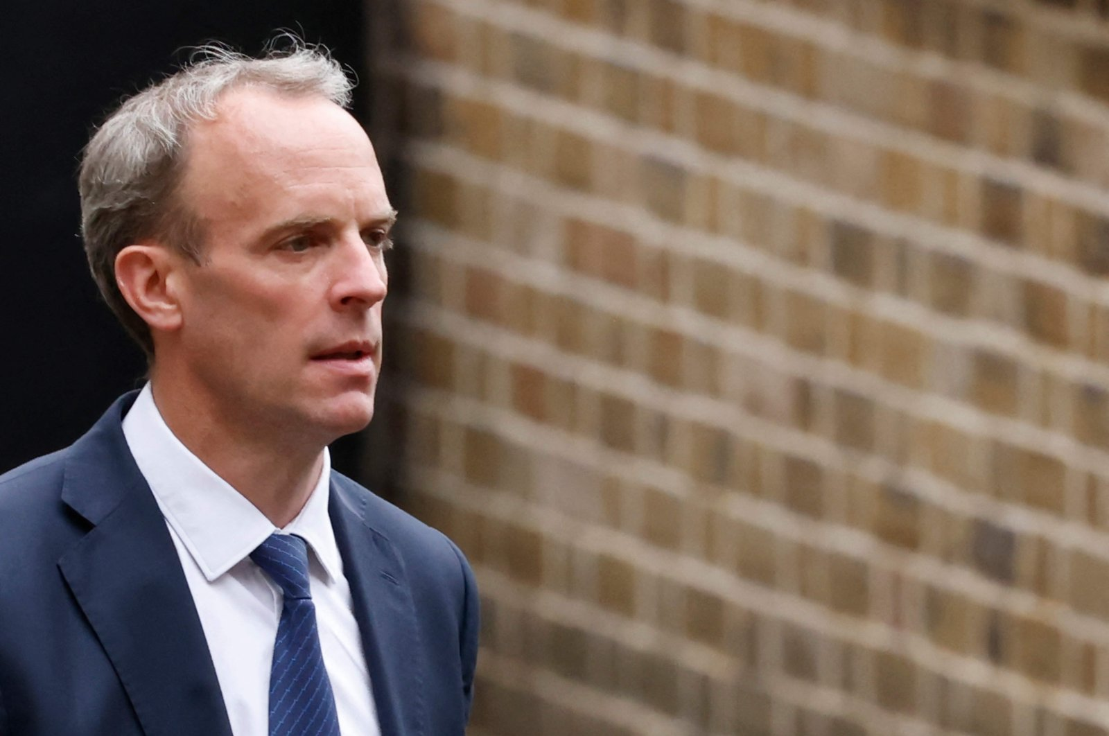 Britain's Foreign Secretary Dominic Raab leaves the Foreign, Commonwealth and Development Office headed for Downing Street in central London, U.K., Aug. 20, 2021. (AFP Photo)