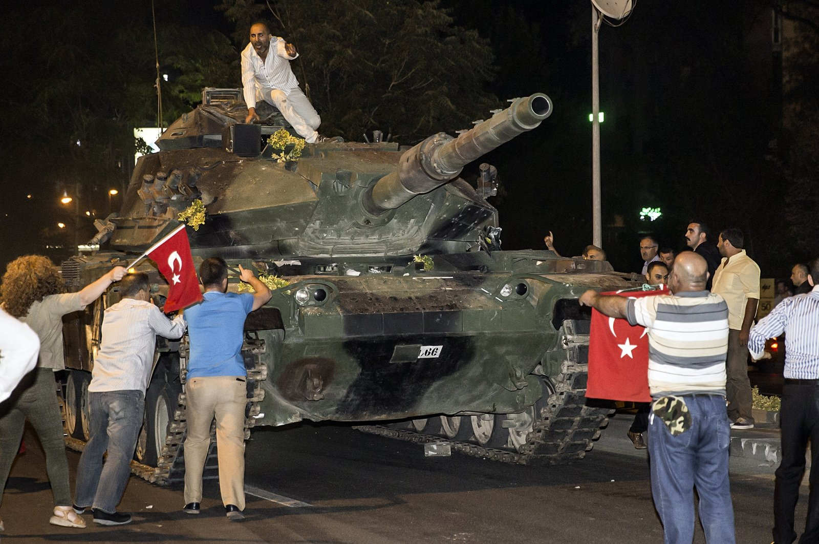People confront a tank controlled by putschists during FETÖ's coup attempt in the capital Ankara, Turkey, July 15, 2016. (AA PHOTO)