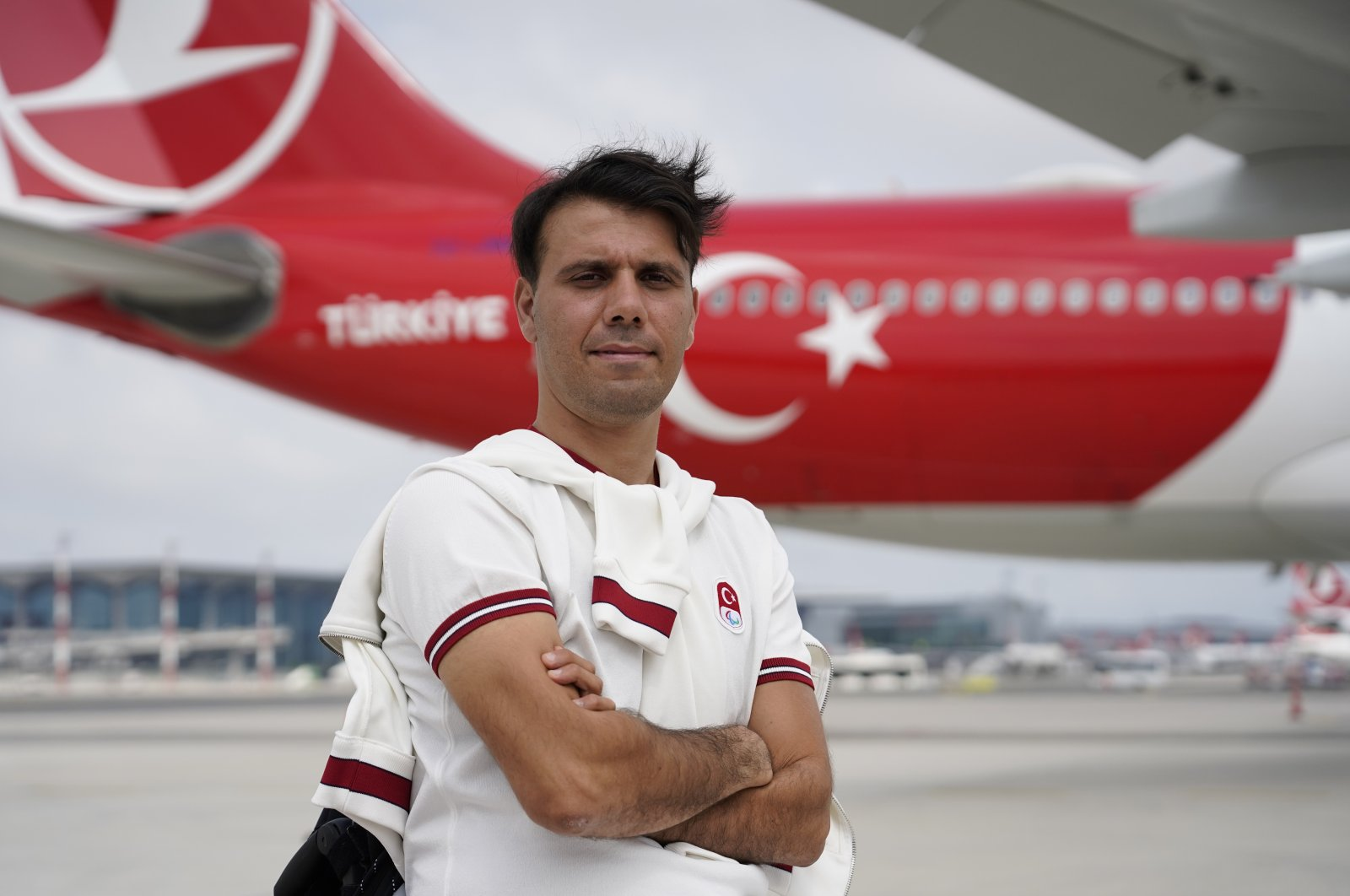 Turkish Paralympic archer Nihat Türkmenoğlu poses for a photo at the Istanbul Airport before departing for the Tokyo 2020 Paralympics, Istanbul, Turkey. (IHA Photo)