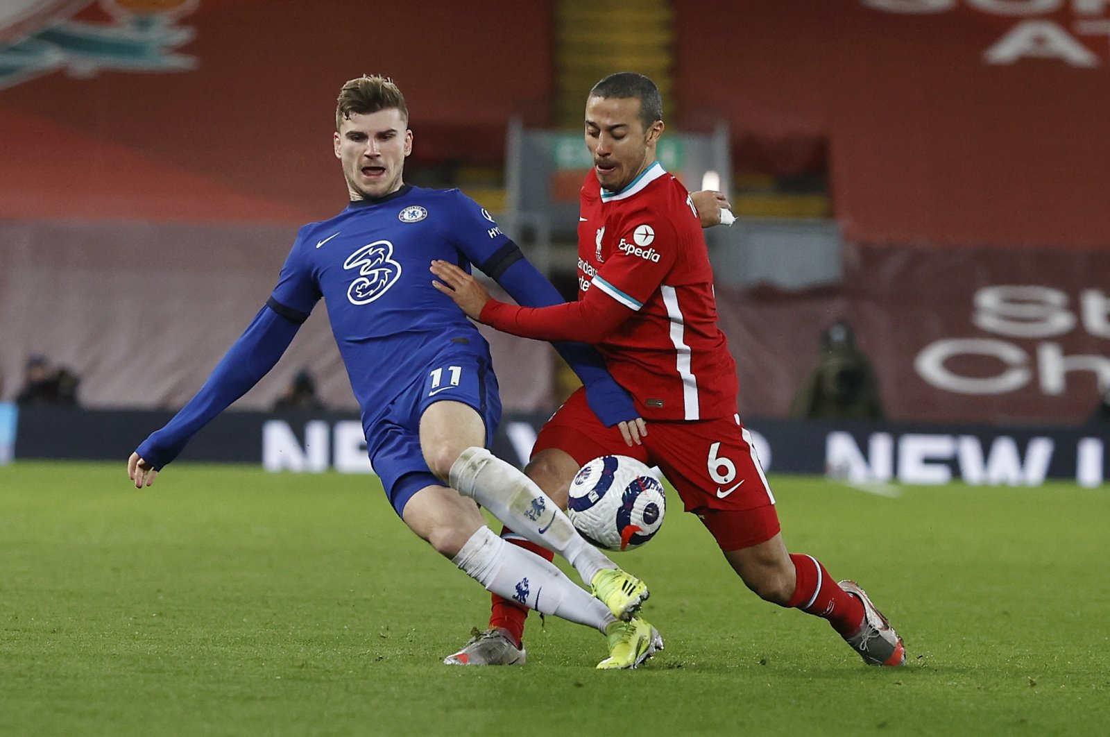 Chelsea's Timo Werner (L) vies for the ball with Liverpool's Thiago during a Premier League match at Anfield stadium in Liverpool, England, March 4, 2021. (AP Photo)