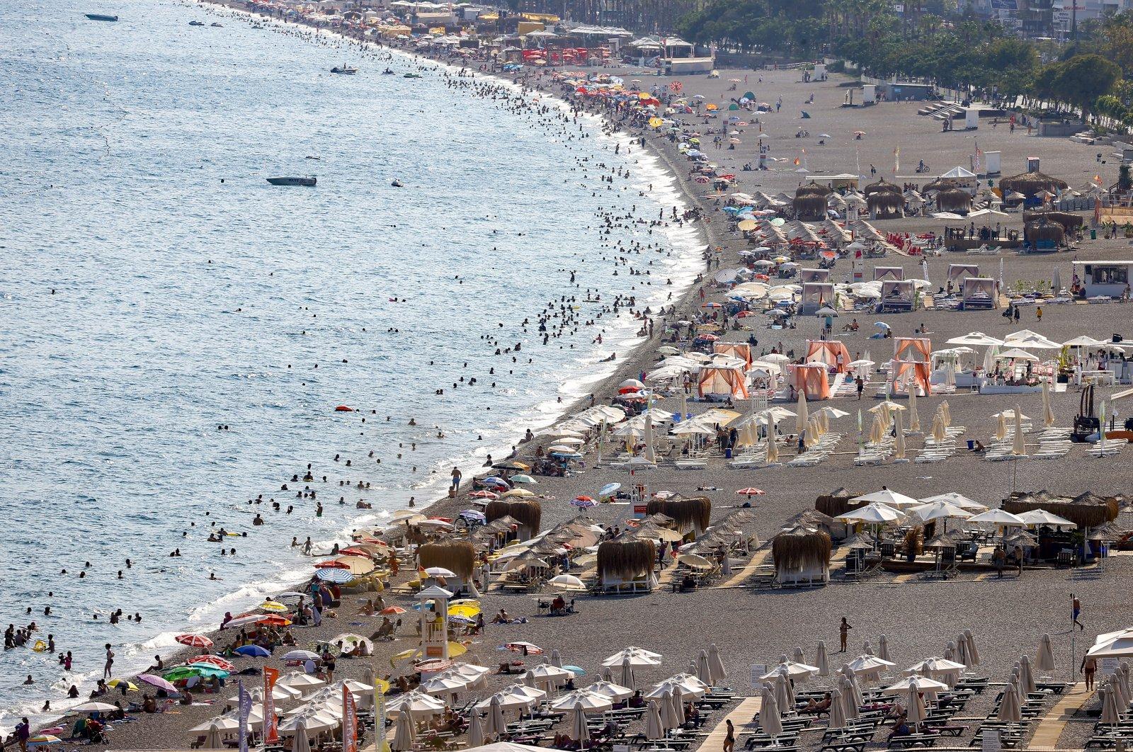 People are seen on a beach in the Mediterranean coastal city of Antalya, Turkey, Aug. 24, 2021. (AA Photo)