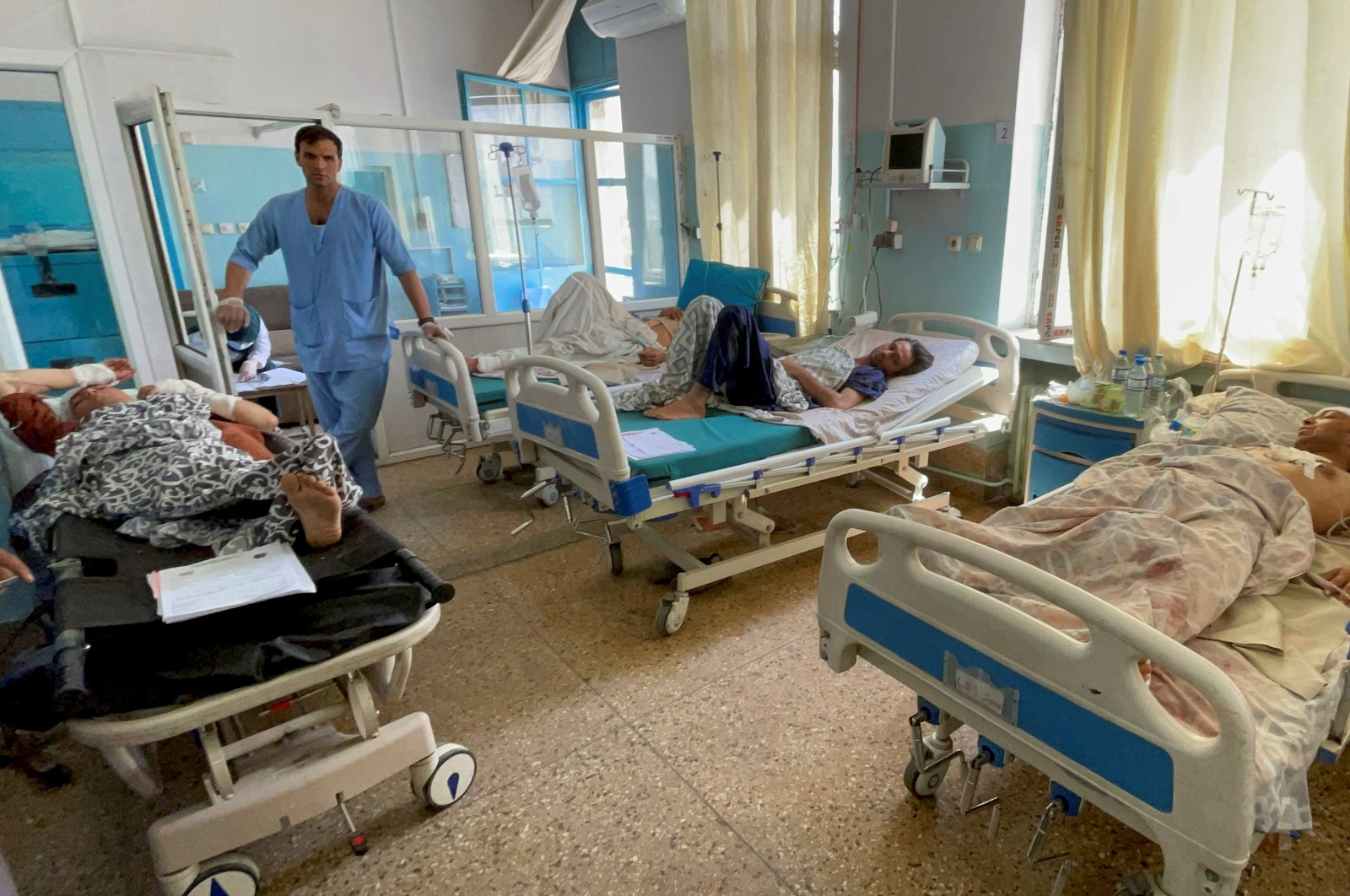 Wounded Afghan men receive treatment at a hospital after explosions outside the airport in Kabul, Afghanistan, Aug. 27, 2021. (Reuters Photo)