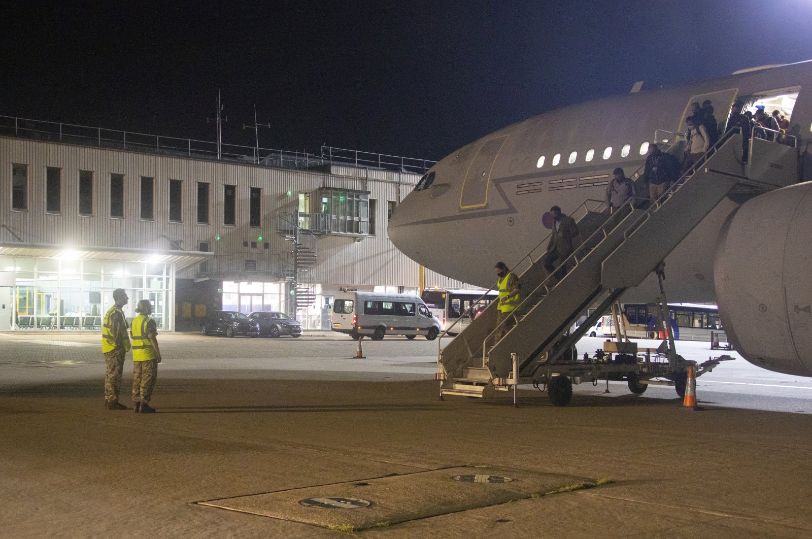 The first flight carrying British Embassy personnel and British nationals evacuated from Kabul, arriving at RAF Brize Norton in Oxfordshire, U.K., on Aug. 16, 2021. (AP Photo)
