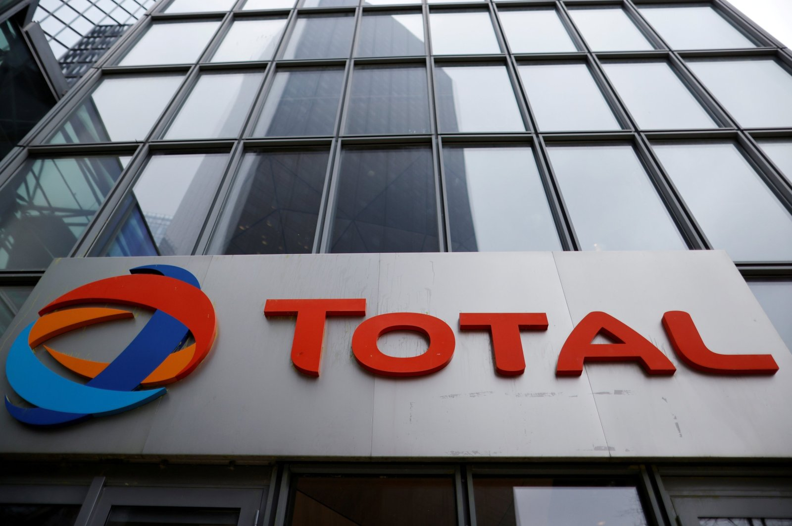 The logo of French oil and gas company Total is seen at La Defense business district in Courbevoie near Paris, France, February 8, 2021. (Reuters Photo)