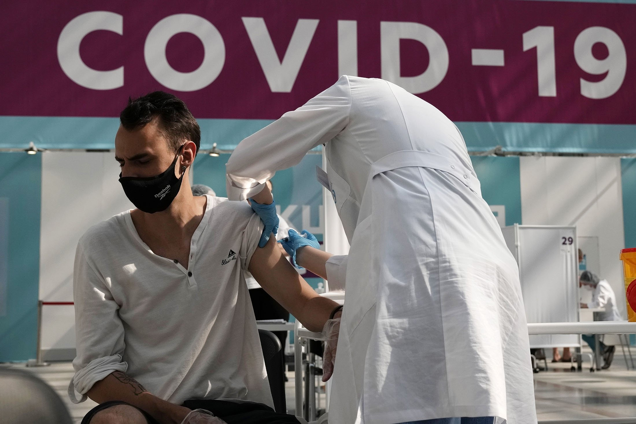 A medical worker administers a shot of Russia's Sputnik V coronavirus vaccine at a vaccination center in Gostinny Dvor, a huge exhibition place in Moscow, Russia, July 12, 2021. (AP Photo)
